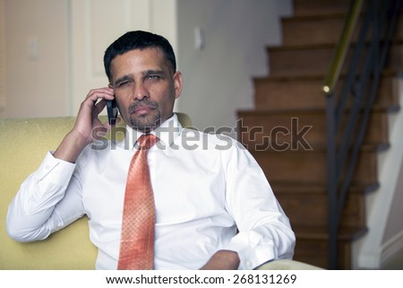 handsome businessman on the phone looking upset - stock photo