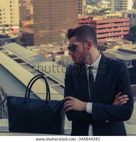 Handsome businessman outdoors wearing sunglasses