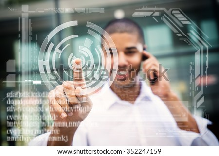 Handsome businessman pointing finger to camera and slicking virtual button, finger is in focus while his face is out of focus. Shallow depth of field. - stock photo