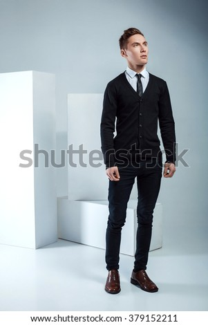 Handsome businessman posing on light background. young attractive and confident man - stock photo