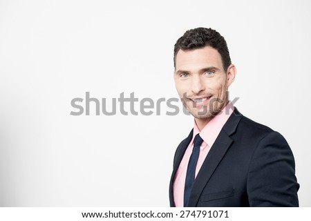 Handsome businessman posing over grey