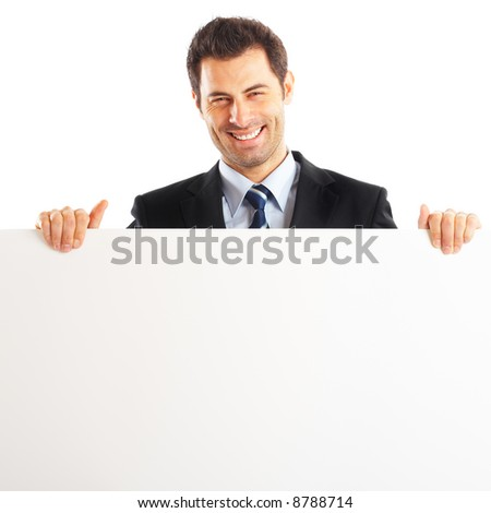 Handsome Businessman shot in studio isolated on white with blank paper sign - stock photo