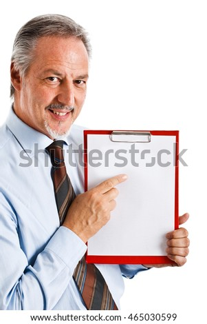 Handsome businessman showing a blank clipboard