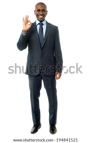 Handsome businessman showing perfect gesture - stock photo
