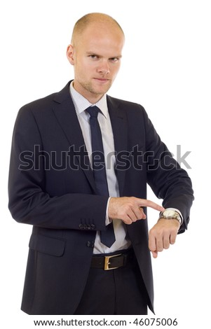 handsome businessman showing time on his watch over white