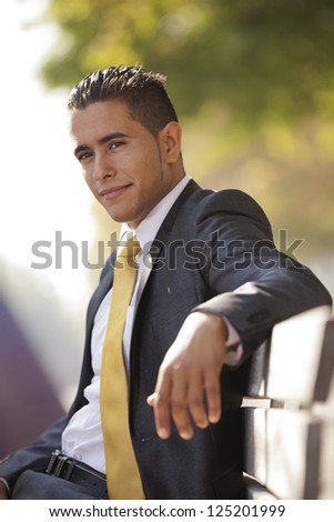 Handsome businessman sited at the bench park