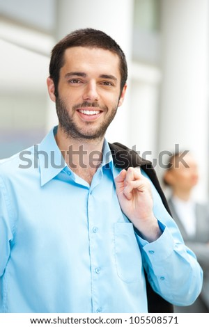 Handsome businessman smiling at camera - stock photo