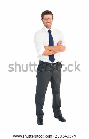 Handsome businessman smiling at camera on white background