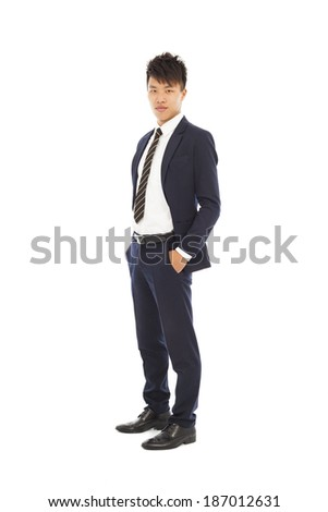 handsome businessman standing and hands in his pockets - stock photo