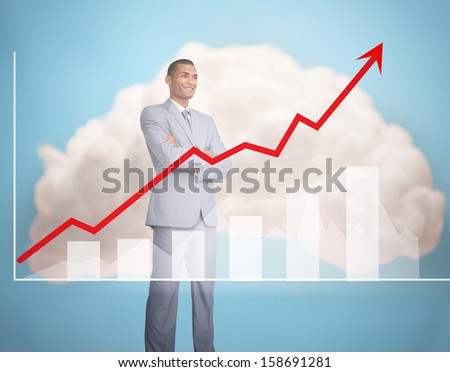 Handsome businessman standing behind graphics on sky background