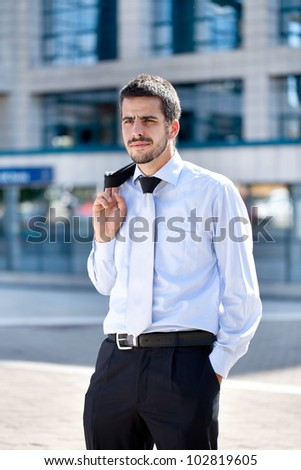 handsome businessman standing front his office building
