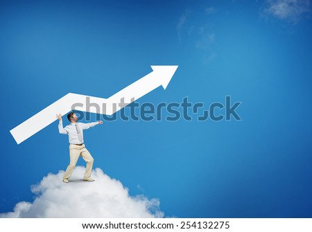 Handsome businessman standing on cloud holding white arrow - stock photo