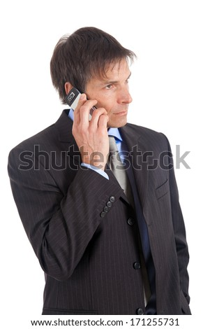 Handsome businessman talking by cellular  - stock photo