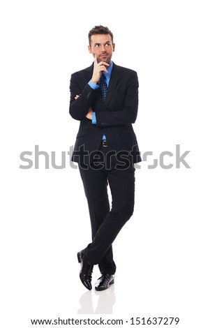 Handsome businessman thinking about something - stock photo