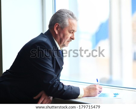 handsome businessman using tablet computer in modern office