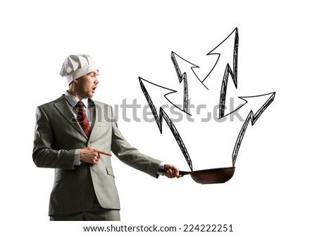Handsome businessman wearing cook hat with pan in hands - stock photo