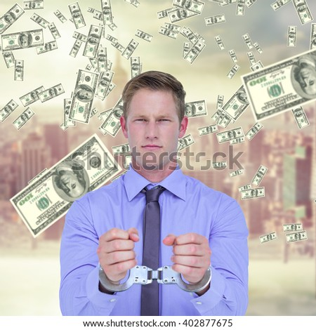 Handsome businessman wearing handcuffs against room with large window looking on city