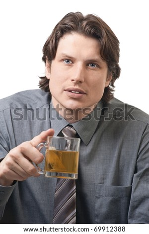 Handsome businessman with a cup of green tea against white background