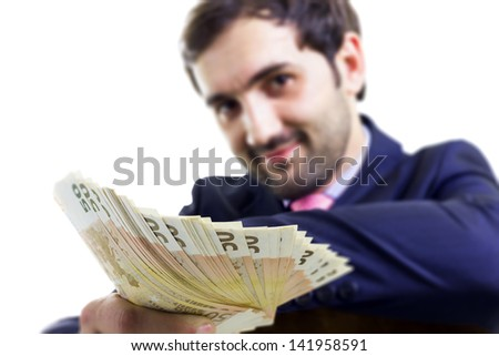 Handsome businessman with a lot of money, isolated on white - stock photo
