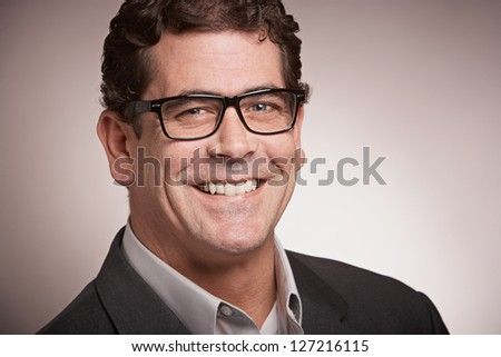 Handsome businessman with glasses closeup portrait