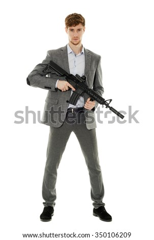 Handsome businessman with machine gun isolated on white - stock photo