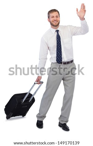 Handsome businessman with suitcase waving against white background - stock photo