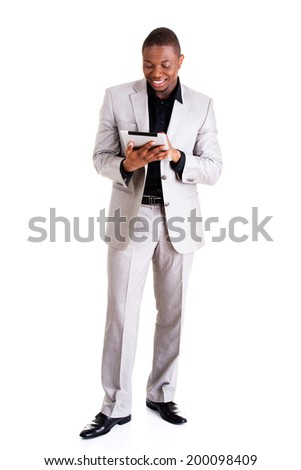 Handsome businessman with tablet computer