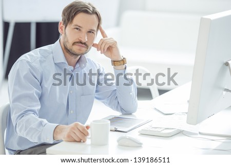 Handsome Businessman working at his desk in office