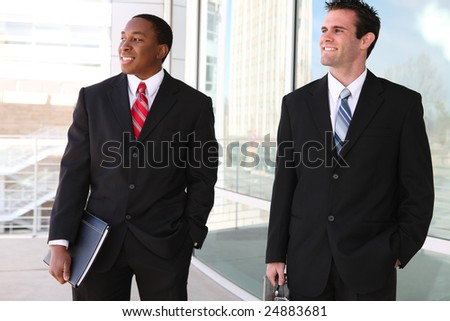 Handsome, busy diverse business men at their company office building - stock photo