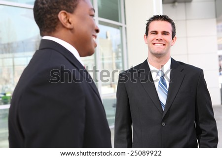 Handsome, busy diverse business men at their company office building