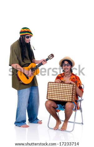Handsome Caribbean, humorous Rasta reggae guy with joint and guitar, nerd tourist in chair.  Studio, white background