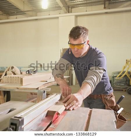 Handsome carpenter man at work - stock photo