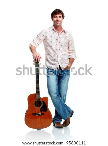 Handsome casual man with guitar. Isolated on white background. - stock photo