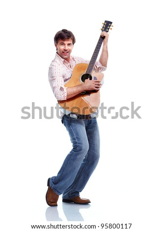 Handsome casual man with guitar. Isolated on white background.