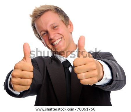 Handsome caucasian executive in business suit gives the thumbs up; selective focus on hands - stock photo