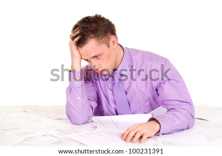 Handsome Caucasian good Businessman very emotional in the papers on a light background - stock photo