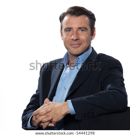 Handsome caucasian man businessman sitting relaxed portrait on white isolated backgroun - stock photo