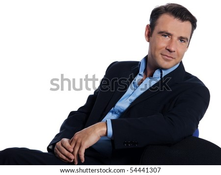 Handsome caucasian man businessman sitting relaxed portrait on white isolated background