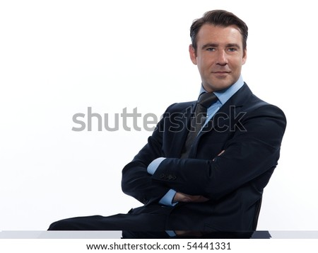 Handsome caucasian man businessman sitting relaxed portrait on white isolated background - stock photo
