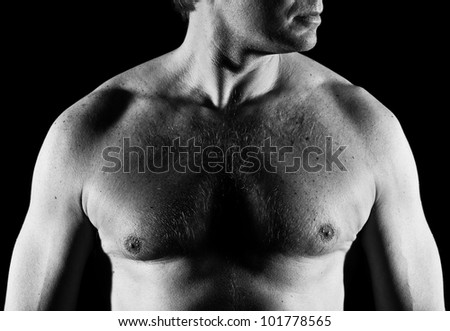 Handsome caucasian man, close-up of chest, black and white image - stock photo