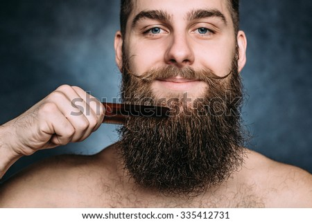 Handsome caucasian man close up with funny mustache comb beard and smile. Horizontal - stock photo