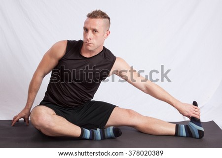 Handsome Caucasian man in a yoga position - stock photo