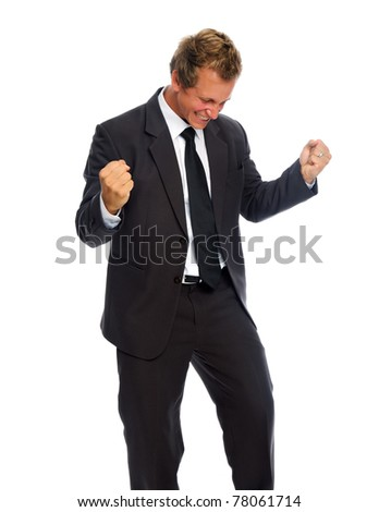 Handsome caucasian man in business suit is happy with success - stock photo