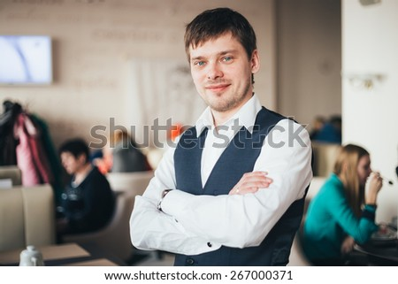 Handsome Caucasian Man In Shirt Staying In Cafe - stock photo