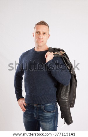 Handsome Caucasian man  smiling at the camera - stock photo