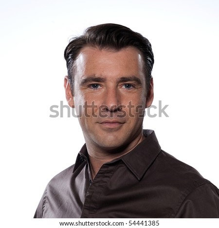 Handsome caucasian man smiling portrait on white isolated background with brown shir - stock photo