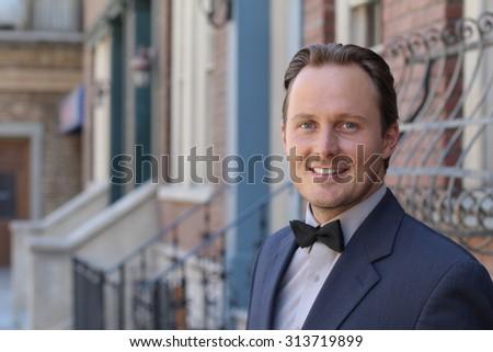 Handsome Caucasian man wearing tuxedo - stock photo
