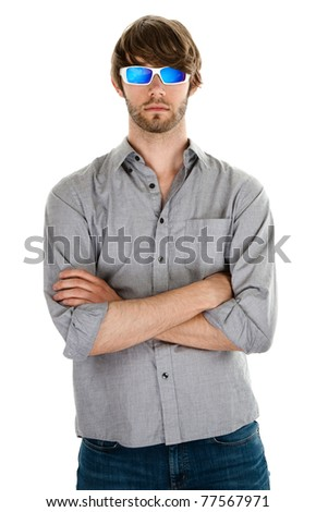 Handsome Caucasian man with hands folded wearing shades on white background - stock photo
