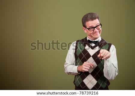 Handsome Caucasian nerd points his index finger - stock photo