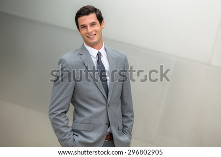 Handsome charming nice looking business executive professional male in a suit smiling successful expression - stock photo